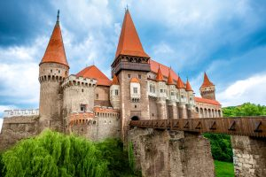 Beautiful view on Corvin castle in cloudy weather. Romanian landmarks