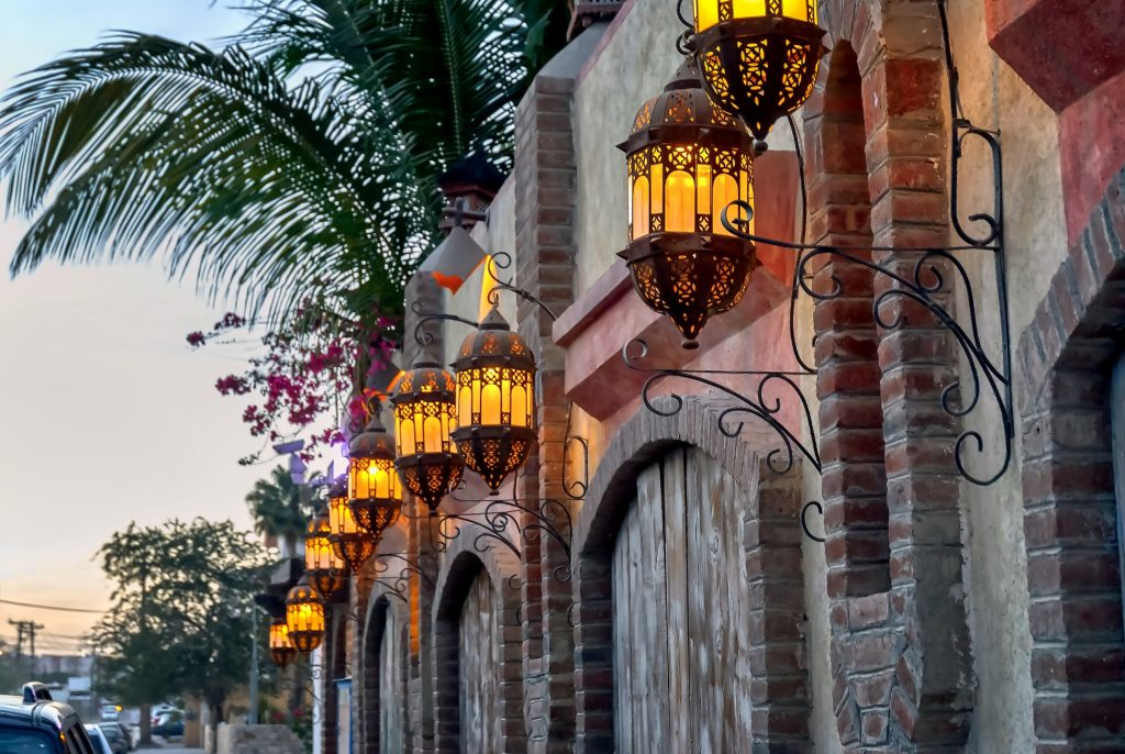 View-of-buildings-and-street-lights-in-Cabo-San-Lucas-Mexico-at-dusk.